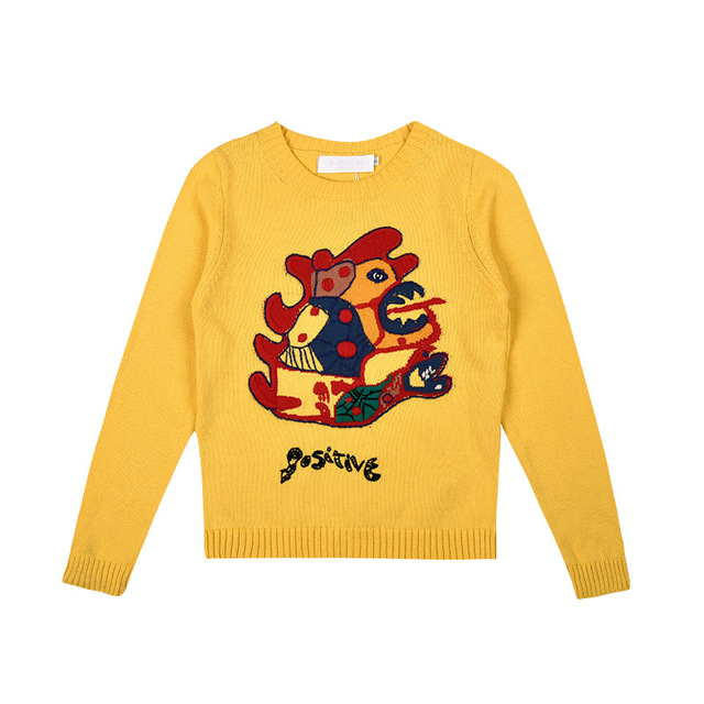 New autumn and winter embroidered little monster knitting European women s round neck yellow sweater