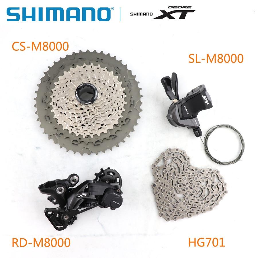 Le groupe SHIMANO DEORE XT M8000 1x11 11 s vitesse 11-40 T 11-42 T 11-46 T contient un levier de manette de vitesse et un déarilleur arrière et une Cassette et une chaîne