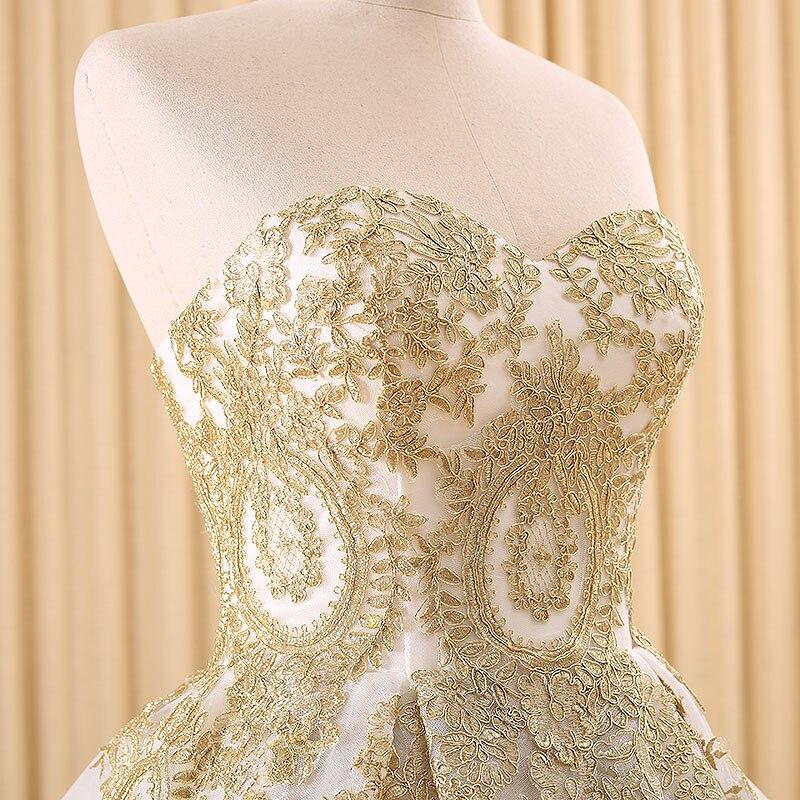 Vestido blanco bordado dorado
