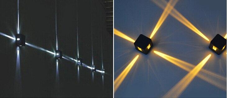 Colorido cruz estrela feixe de luz lâmpada