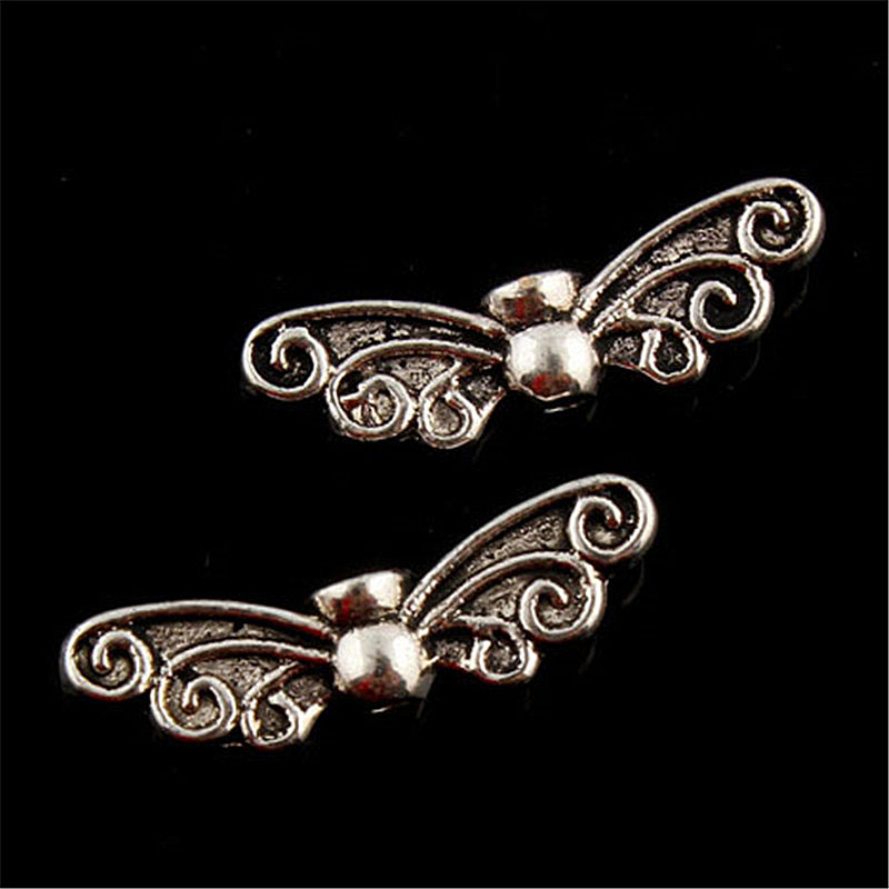 все цены на 20pcs Tibetan Silver Plated double sided angel wings Charms Pendants for Jewelry Making DIY Handmade Craft 26*5mm
