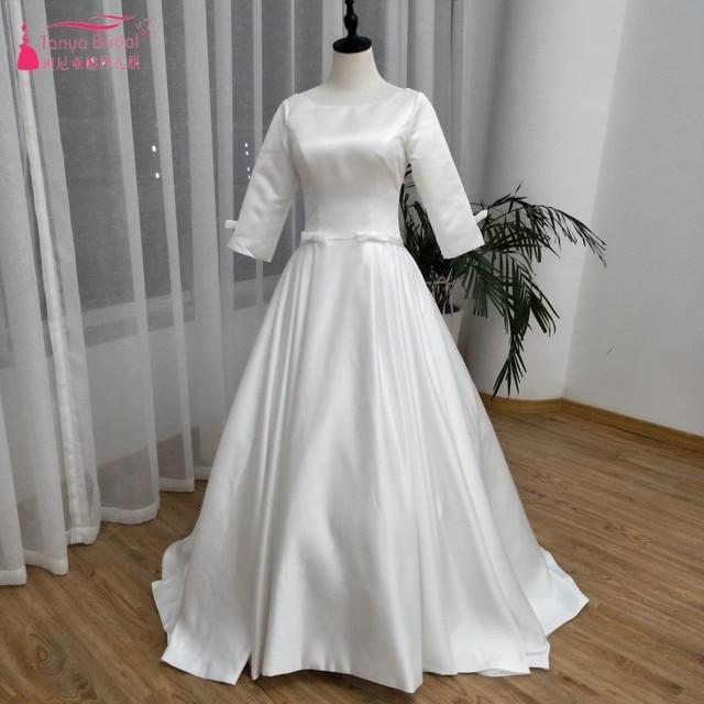 67a303b8dad Three Quarter Jewel Wedding Dresses Muslim Simple Satin elegant Bridal  Dresses 2019 Vestidos De Noiva China