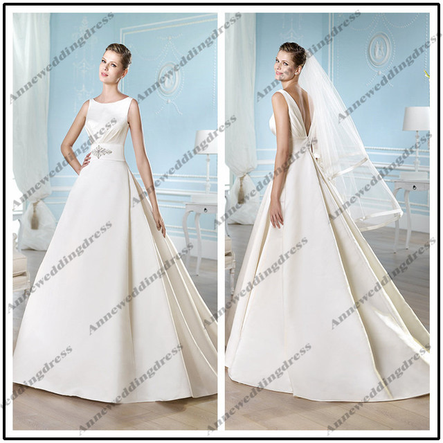 5d3af436d92939 WL10246 Traditional sleeveless boat neck ball gown floor length chapel  train pleated satin wedding dress