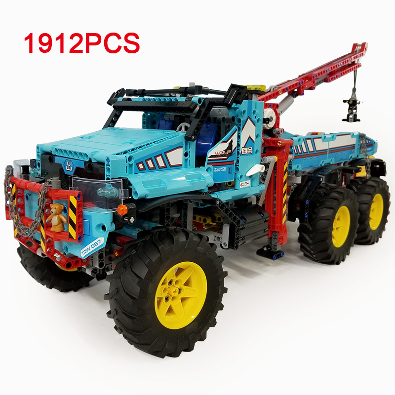 все цены на New Technician technics radio remote control 6x6 all terrain tow truck Pickup building block model brick 42070 rc toy collection онлайн