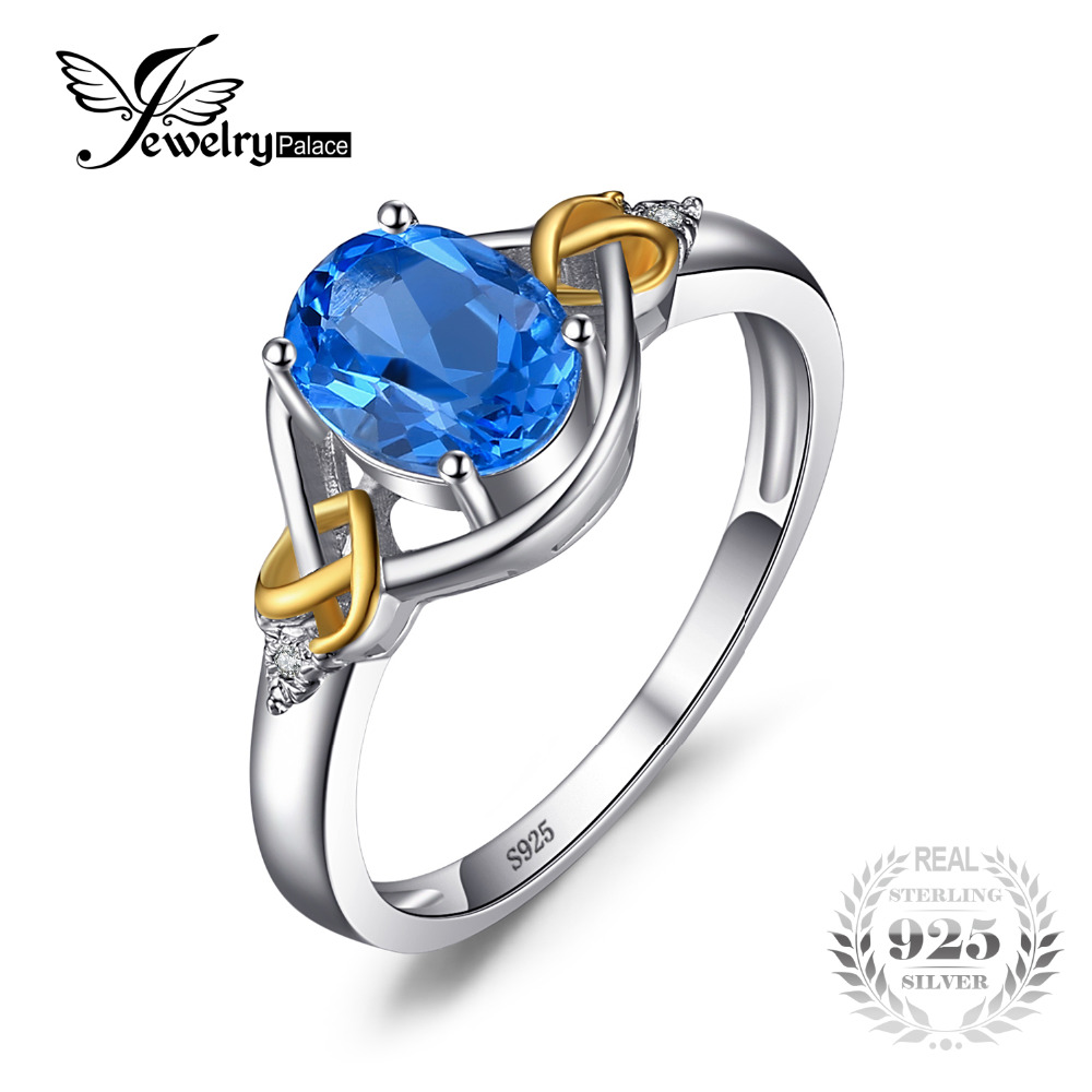 JewelryPalace Love Heart Knot 1.5ct Natural Blue Topaz Real Diamond Accented 925 Sterling Zilver 18K geel gouden ring voor dames