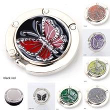 Gancho metálico de suspensión redondo soporte único plegable portátil mariposa patrón moda gancho para mesa 1 Uds cristal aleación bolso