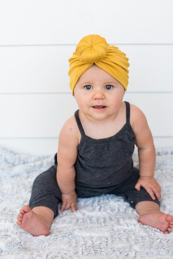 Коллекция года, Детские аксессуары для новорожденных, малышей, детей, малышей, маленьких мальчиков и девочек, тюрбан, хлопковая шапка, зимняя теплая мягкая шапка, одноцветные, с узелком, мягкая шапка