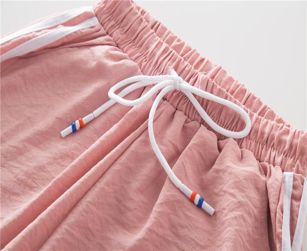 אופנה מזדמן ריצה תרגיל מכנסיים ריקוד נשי צד קווי מכנסי טרנינג ספורט נשים מכנסיים כושר רופף הרמון מכנסיים Bottoms