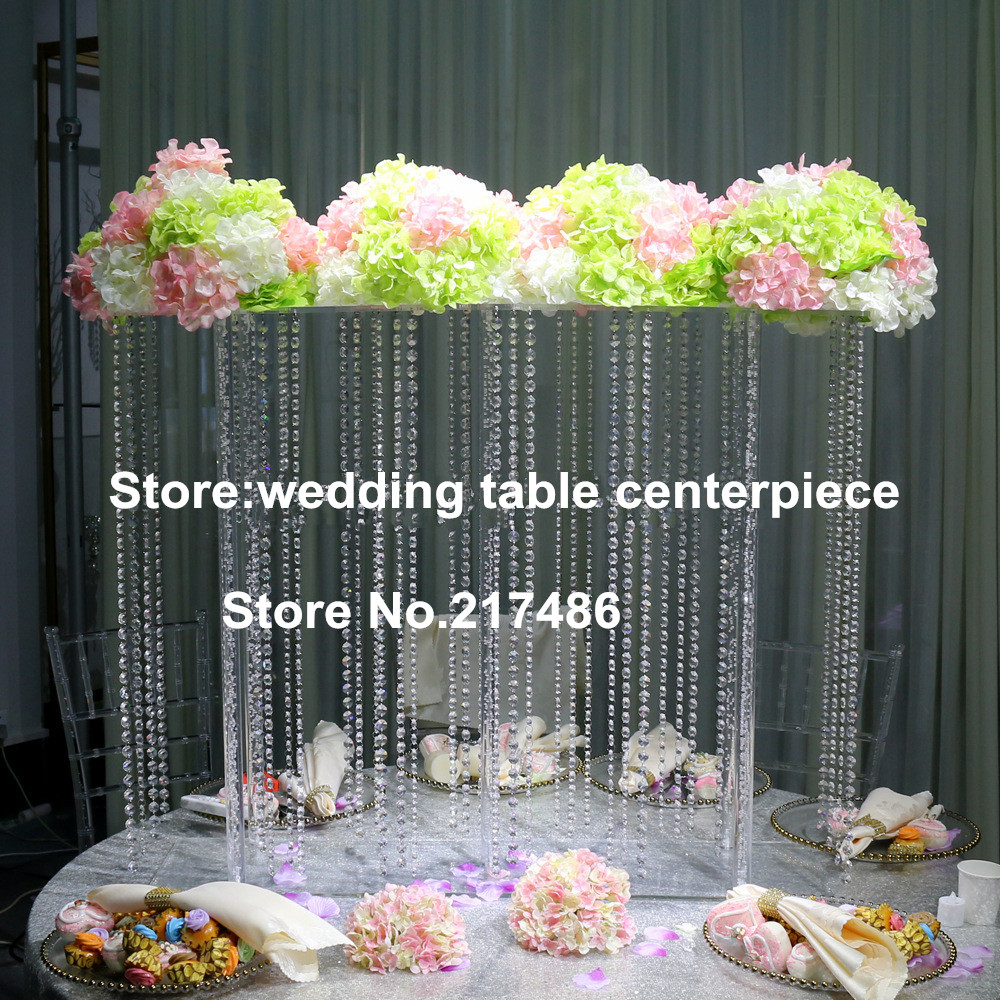 Trumpet shaped tall clear flower arrangements for wedding for Decoration de stand