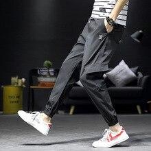 Mens European and American style new wide-tube overalls Multi-pocket slim mid-rise elastic feet