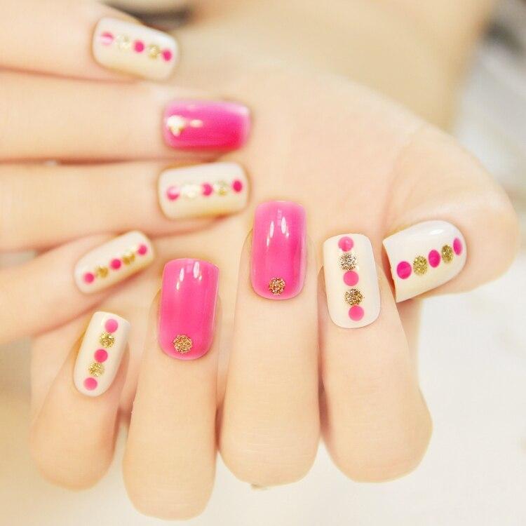 medium length pink false nail art