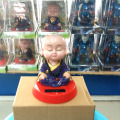 Free Shipping 2 Pieces Per Lot  Nodding Head  Under Full Light  No Battery Novelty Buddhism Items  Solar Energy Monk Toys