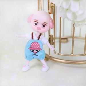 Image 5 - DBS 1/12 BJD 26 joint body cute pig ob11 doll con vestiti scarpe regalo per bambini 15cm mini doll nome di DODO