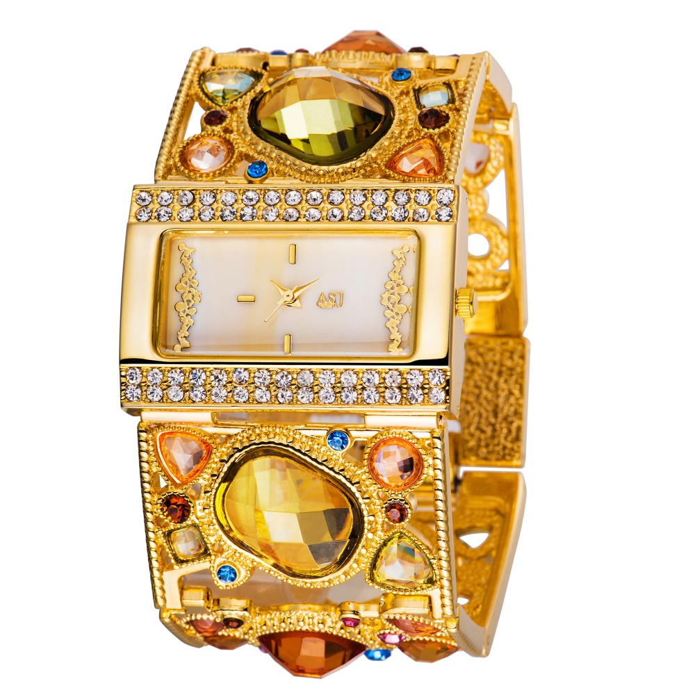 Amazing Women's Golden Armbandsur med graciös Multi Color Diamond Decoration, guld analoga ihåliga gravyr kvinnor klockor