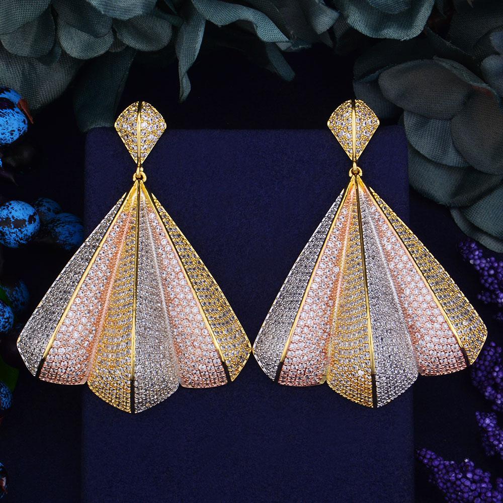 купить GODKI Luxury 68mm Delicate Luxury Gemoetric Design Cubic Zirconia Party Wedding Saudi Arabic Dubai 3 Tone Interval Drop Earrings недорого