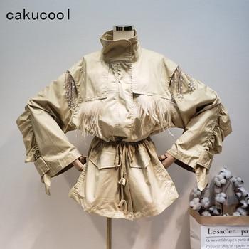Cakucool avestruz pelo parche cordón mujeres chaqueta Emprie plisado cintura ropa caqui con volantes Delgado abrigo cortavientos para mujer