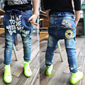 Печать мальчик джинсы 2015 новый бренд зима стиль девушки брюки узкие среднего талии твердые брюки днища размер дети печать мальчик джинсы