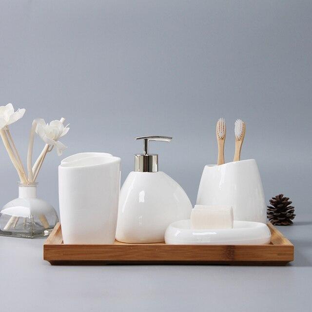 Set Salle De Bain.Us 27 22 28 Off Aliexpress Com Buy Bathroom White Soap Dispenser Toothbrush Accessories Four Piece Set Ceramics Crafts Kit Banheiro Salle De Bain