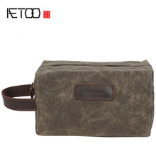 лучшая цена AETOO New men and women hand-wrapped oil wax canvas wash bag retro boy bag holding the first layer of leather wrist bag