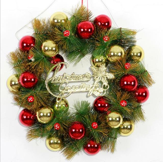 christmas wreath decorated with christmas decorations christmas ornaments door door hanging holiday hotel mushroom balls