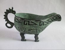 The ancient Chinese antique bronze inscriptions dragon wine glass sculpture