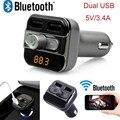 Bt20 FM manos libres Bluetooth MP3 reproductor de música del TF del disco de U encendedor del coche Dual del coche del USB cargador Universal