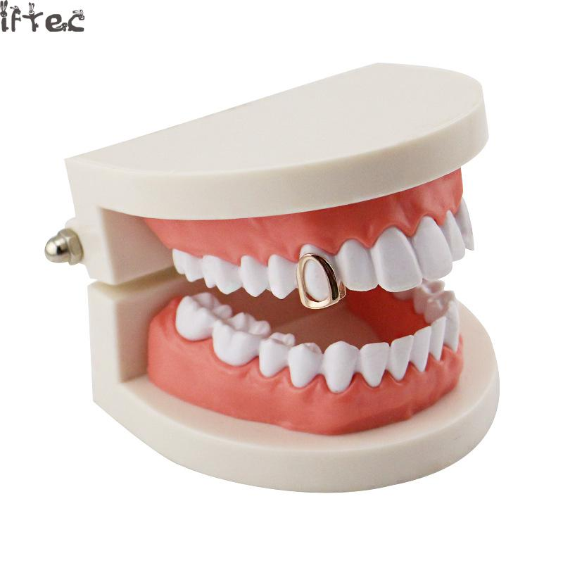 Iftec Hip Hop Gold Hollow Open Face Grillz Single Top Teeth Grillz Dental  Tooth Caps Halloween Party Gifts Jewelry-in Body Jewelry from Jewelry ... e1bbeff210a7