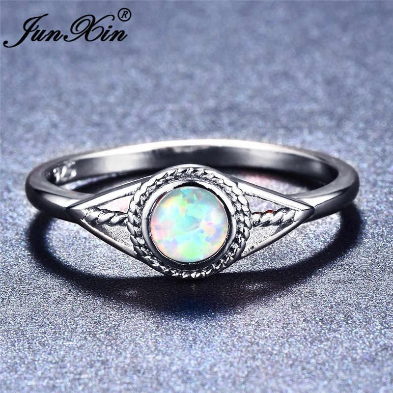 JUNXIN 925 เงินสเตอร์ลิงที่เต็มไปด้วยสีม่วง/สีฟ้า/สีขาวโอปอลไฟแหวนสำหรับผู้หญิงรอบวันเกิดรุ้ง Evil Eye แหวนแต่งงาน