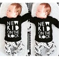 Nuevo 2016 bebé ropa infantil ropa de algodón letra impresa traje de bebé de manga larga t-shirt + pants 2 unids ropa conjuntos