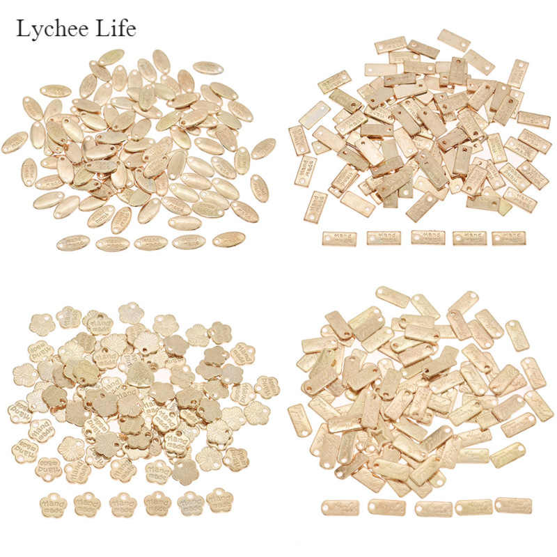 ลิ้นจี่ Life 100PCS Gold Handmade Letter ป้ายโลหะสำหรับเสื้อผ้ากระเป๋า DIY เย็บหมวดหมู่เสื้อผ้าอุปกรณ์ตกแต่ง