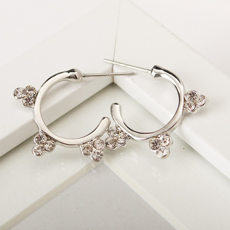 Song Hui Qiao with the semi-circular curved three crystal sun flower earrings for women 4ED371 image