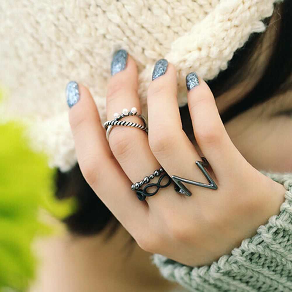 ใหม่วงดนตรี Midi แหวน Knuckle แหวนแฟชั่นเครื่องประดับ 4 ชิ้น/เซ็ต Black Silver Punk แหวนแฟชั่นผู้หญิง Grils ร้อนขาย