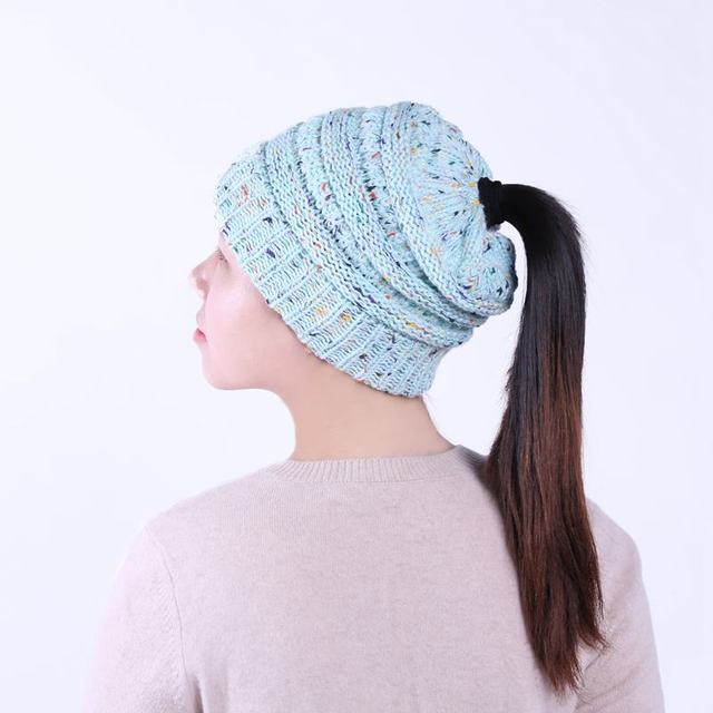 BeanieTail Soft Stretch Cable Knit Messy High Bun Ponytail Beanie ... 74d0957ba17