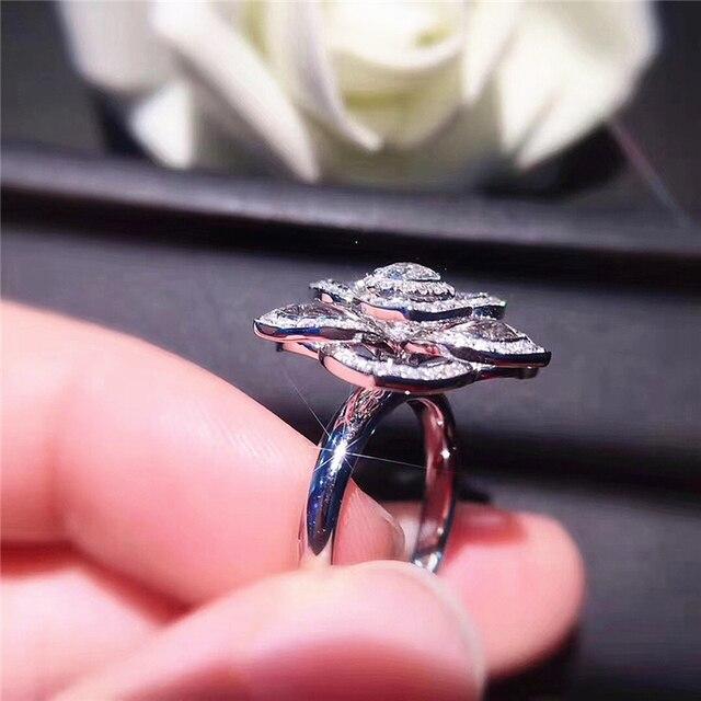 Купить женское кольцо с цветком из серебра s925 пробы фианитом и камнями