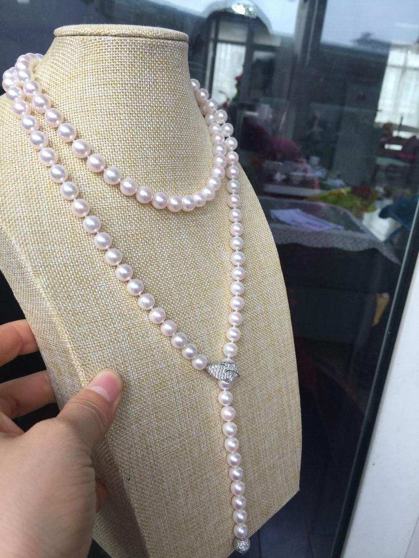 Magnifique collier de perles blanches rondes Akoya 8.5-9mm 40 pouces en argent