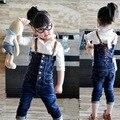 Девушка джинсы Бесплатная доставка моды ковбойские штаны детей джинсовые комбинезоны осенние детей брюки высокое качество оптовая торговля розничная торговля