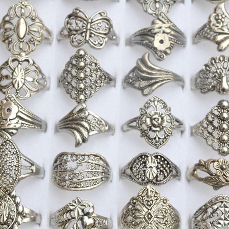 Prix pour 100 Pcs En Gros Bijoux Lot Mixte Style Tibet Argent Vintage Anneaux Creux Conception Fleur Argent Anneaux Pour Hommes Femmes