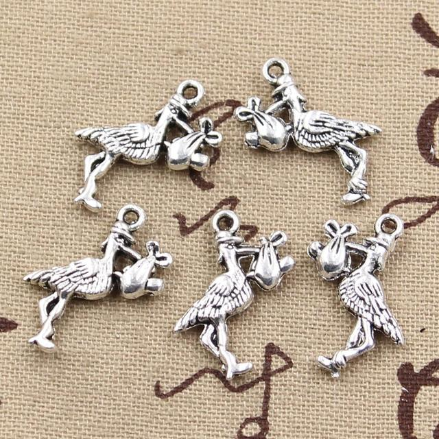 20 piezas dijes stork baby bird 23x18mm colgantes plateados antiguos que hacen joyería de plata tibetana hecha a mano DIY