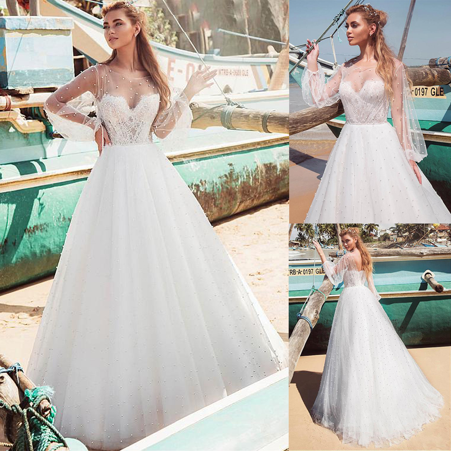 Gorgeous Tulle Bateau Neckline A line Wedding Dresses With Imitation Pearls Long Sleeves Pearls Bridal Gowns