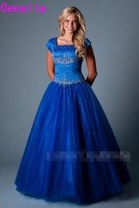 Image 1 - Hoàng gia Blue Ball Gown Dài Modest Prom Dresses Với Cap Tay Áo Đính Cườm Crystals Tầng Chiều Dài Cô Gái Thanh Thiếu Niên Trang Phục Chính Thức Prom Đảng gowns
