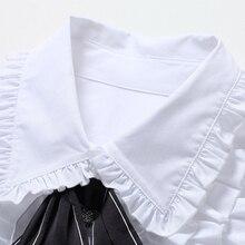 قميص نسائي أنيق بأكمام طويلة واسعة ورفرف من الأمام وربطة عنق سوداء