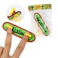 Plástico Mini Diapasón Finger Skate Profesional dedo skate para niños artículos de la novedad de Juguete con primavera y el anillo