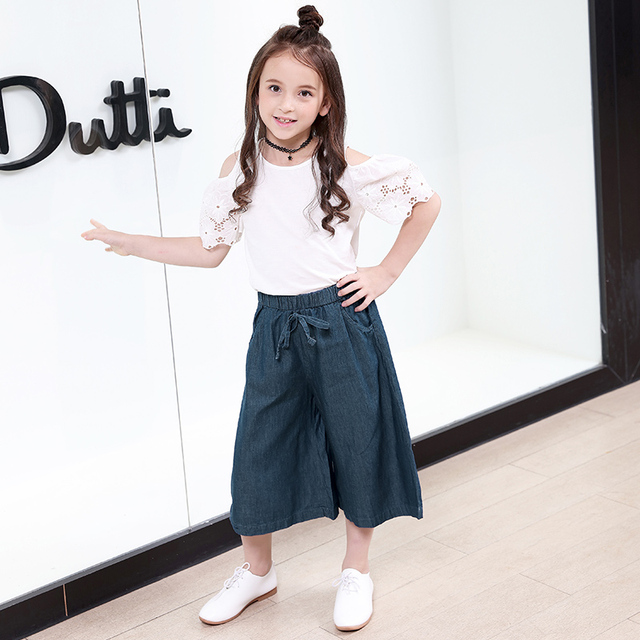 b5190065db606 US $30.78 13% OFF Fashion Girls Clothing Set 2018 Summer Kids Girl Clothes  White Top Blouse Open Shoulders+Denim Pants Wide Leg Children Costume-in ...