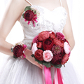 The wine red peony flower bride hand holds flowers red bridesmaid wedding bouquet