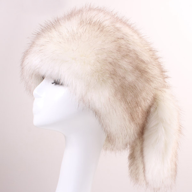 67ee57c57c4 High Quality Women Winter Hats Faux Fur Bomber Hats with Cute Fur Tails  Soft Fur Caps for Women Russian Mongolia Hats for Men