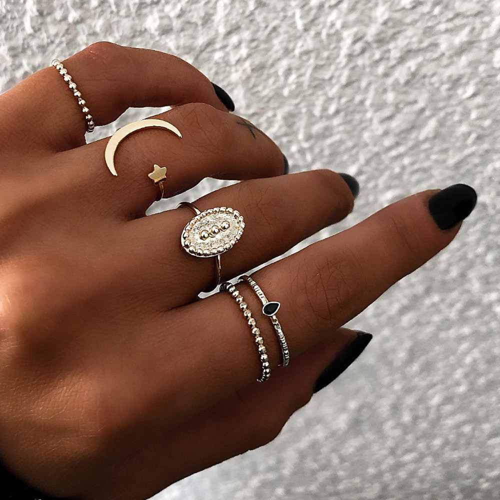 pack of 5 simple knuckle rings with stars and crescent moon embossed design in burnished image