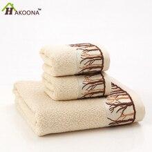 Hakoona estilo bush face towel patrón en relieve bordado de fibra de bambú jacquard interrumpido estropajos café color blanco 34×72 cm