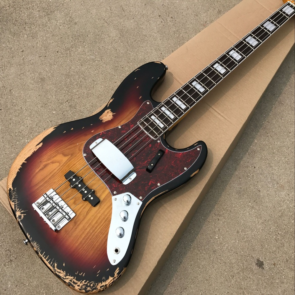 Hot sell 1959 relic Jazz bass basswood body with 4 strings electric bass in sunburst color , hight quality rotosound rs77ld jazz bass flatwound strings monel