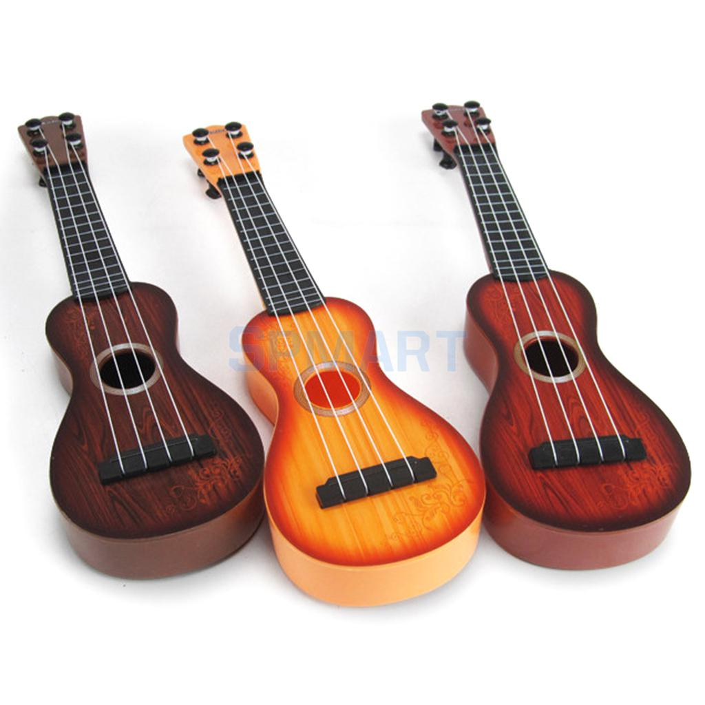 4 strings musical plastic toy ukulele small guitar for beginners kids child in toy musical. Black Bedroom Furniture Sets. Home Design Ideas