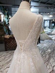 Image 5 - LSS508 ボヘミアンウェディングドレス v ネックノースリーブ a ライン格安ウェディングドレスシンプルなビーチブライダルドレス vestidos デ noiva 2020